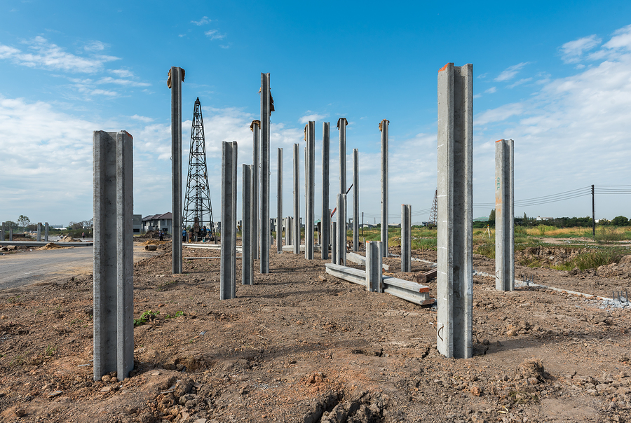 construction site with precast concrete pile and pile-driver, prefabrication house structure design