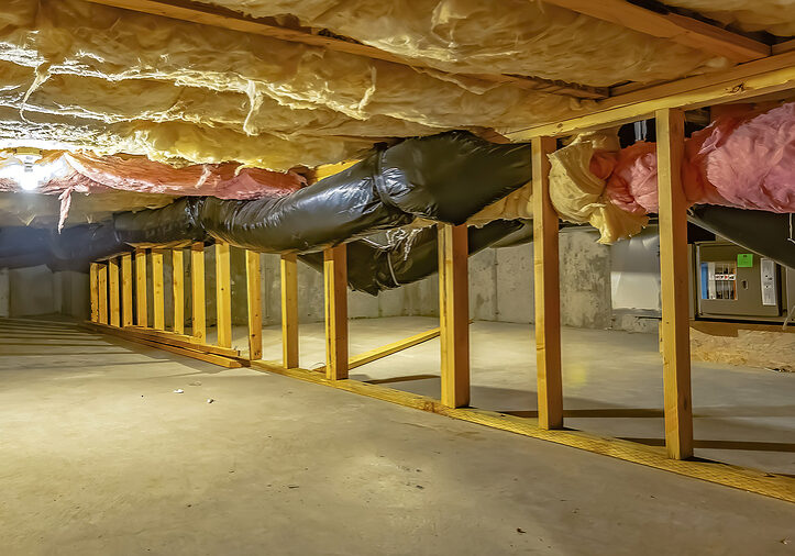 panorama basement or crawl space with upper floor insulation and wooden support beams